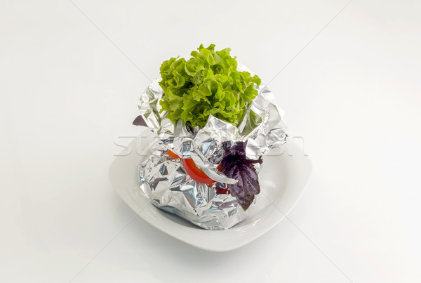 Meat with vegetables baked in aluminum foil Stock photo © fogen