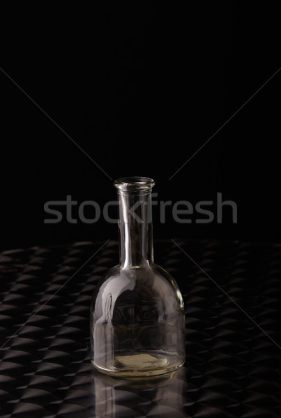 Glas fles lege gepolijst roestvrij staal tabel Stockfoto © forgiss