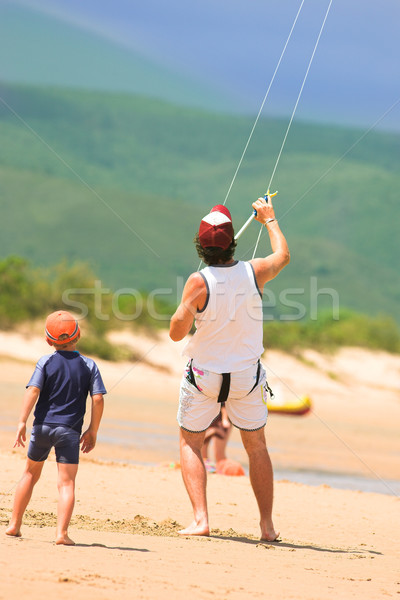 Kite surfer on the beach with a boy Stock photo © Forgiss