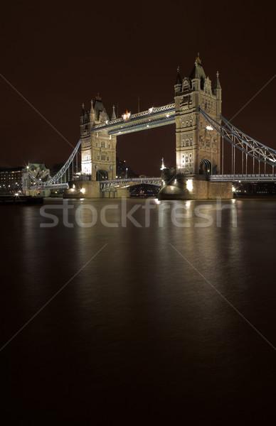 Tower Bridge Londres cena noturna cópia espaço água Foto stock © Forgiss