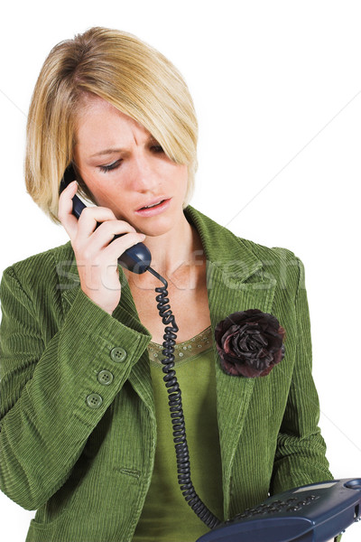 Mulher de negócios verde jaqueta falante telefone olhando para baixo Foto stock © Forgiss
