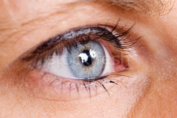 Oog Blauw vrouwelijke eyeliner ondiep horloge Stockfoto © Forgiss