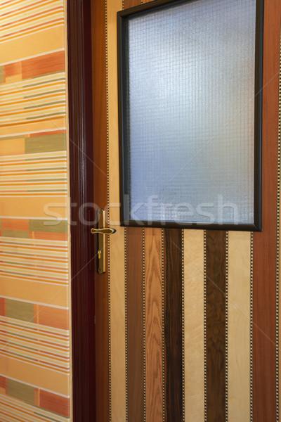 Wooden patterned door in hallway Stock photo © Forgiss