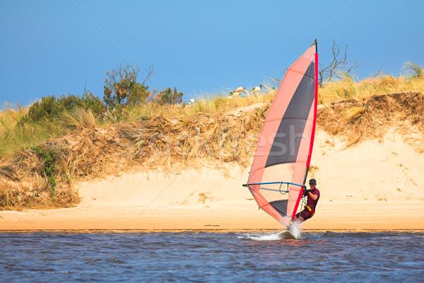Fast moving windsurfer Stock photo © Forgiss