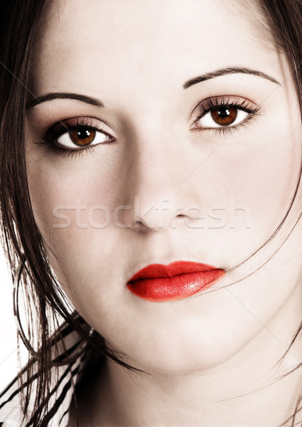 Beautiful woman with sepia look and saturated added colors Stock photo © Forgiss
