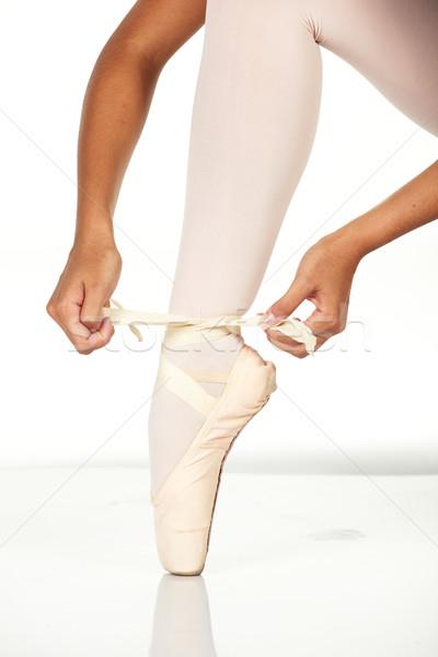 Tying ballet shoes Stock photo © Forgiss