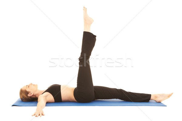 Pilates oefening geschikt jonge brunette instructeur Stockfoto © Forgiss