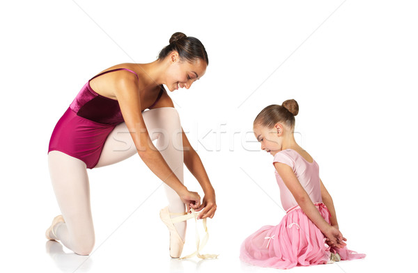 Tying ballet shoes Stock photo © Forgiss