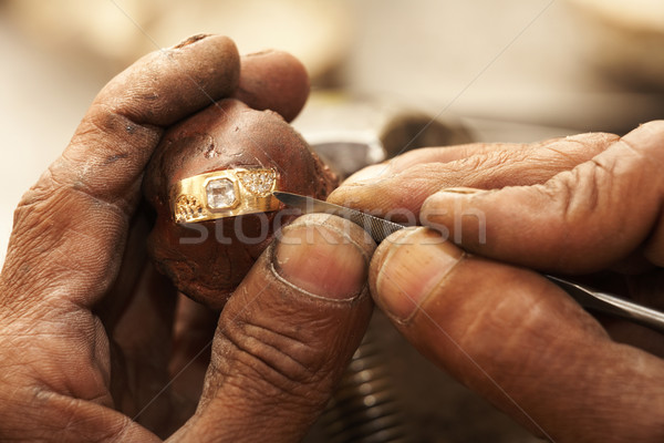 Jeweler making rings Stock photo © Forgiss