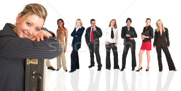Blonde businesswoman standing in front of a business people grou Stock photo © Forgiss