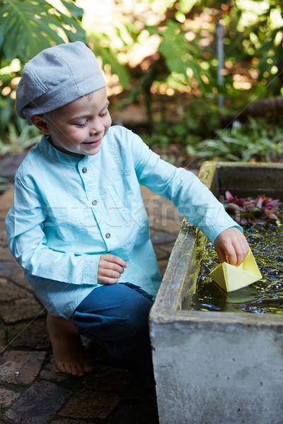 Carta origami barca piccolo quattro anni ragazzo Foto d'archivio © forgiss