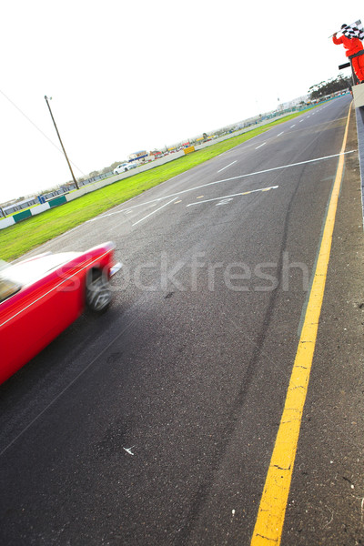 Speeding racer on racetrack Stock photo © Forgiss