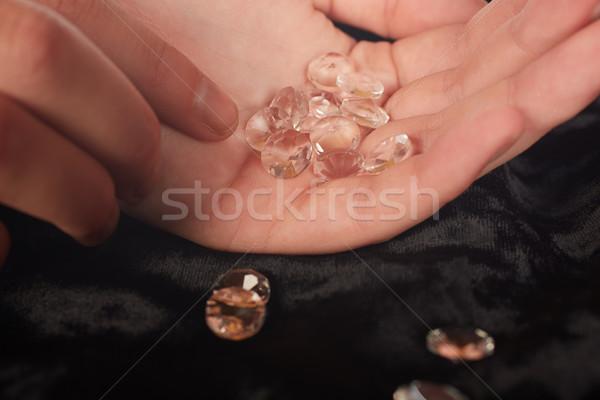Diamonds in hand Stock photo © Forgiss