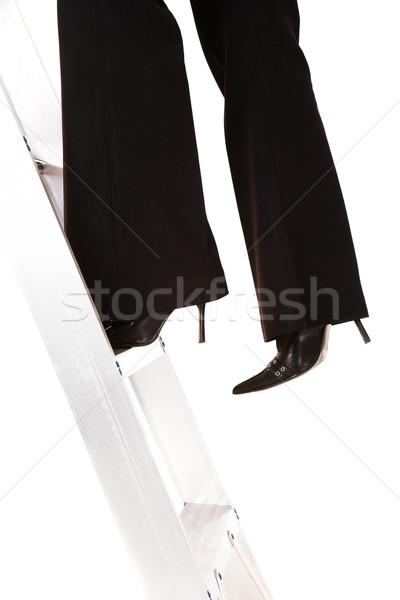 Escalera éxito mujer de negocios escalada aislado blanco Foto stock © Forgiss