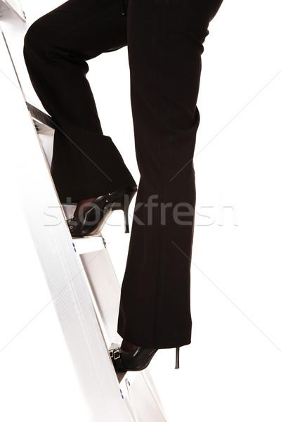 Ladder succes zakenvrouw klimmen geïsoleerd witte Stockfoto © Forgiss