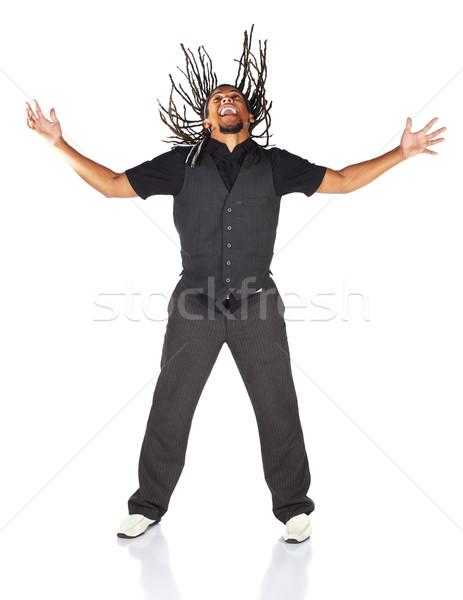 Guapo África empresario traje negro saltar alegría Foto stock © Forgiss
