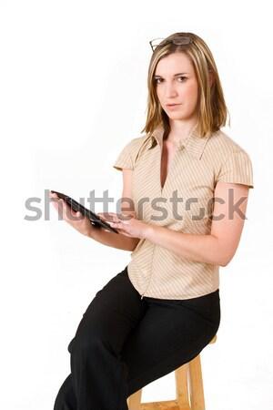 Szczęście business woman Kalkulator posiedzenia krzesło pracy Zdjęcia stock © Forgiss