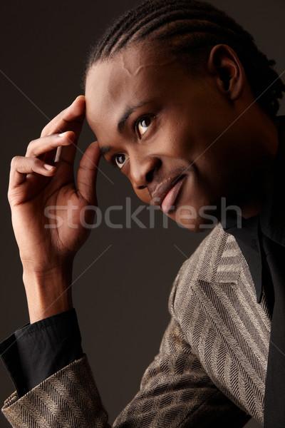 Preto empresário africano escuro posições Foto stock © Forgiss