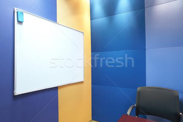 Whiteboard against blue wall Stock photo © Forgiss