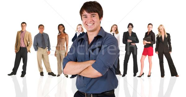 Genç işadamı ayakta iş adamları grup yakışıklı Stok fotoğraf © Forgiss