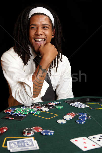 Cartão jogos de azar jovem africano homem cartas de jogar Foto stock © Forgiss