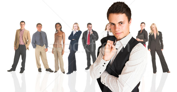 Formal businessman standing in front of a business people group Stock photo © Forgiss