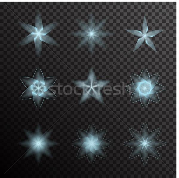 Vector set of glowing light bursts on black Stock photo © Fosin