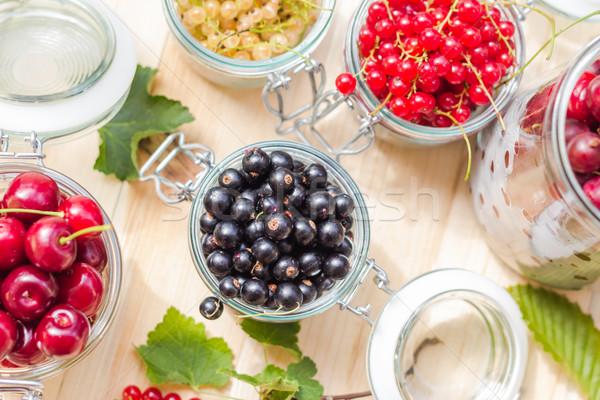 black red white currants gooseberries cherries jars preparations Stock photo © fotoaloja