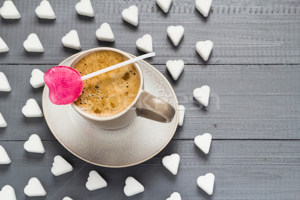 Stock photo: cup coffee sweets heart shaped lollipop sugar cubes