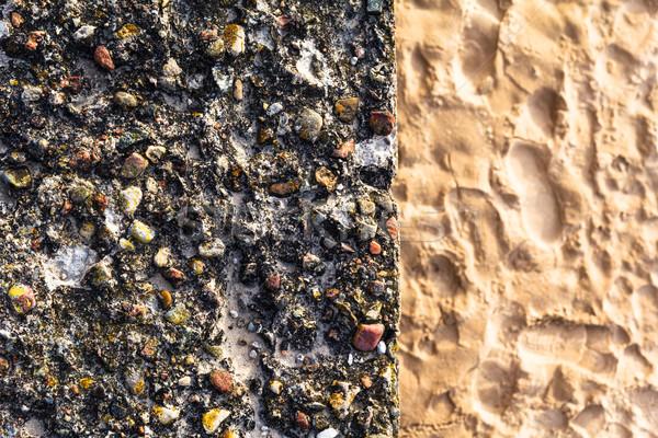 Concrete wall colorful pebbles sand Stock photo © fotoaloja