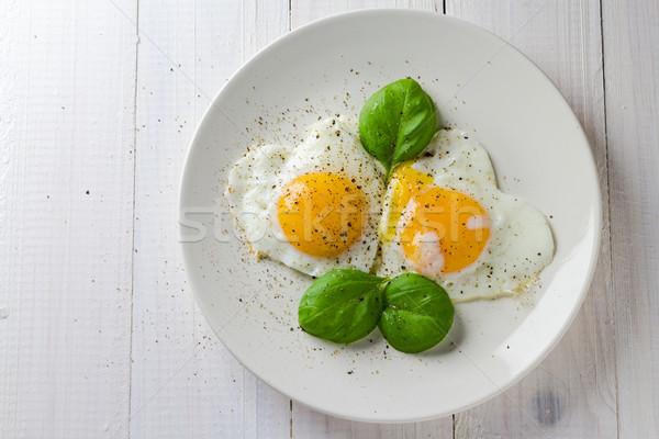 フライド 卵 心 皿 ストックフォト © fotoaloja
