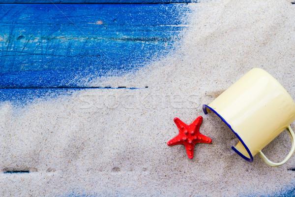 colorful shells cup sand strewn blue boards Stock photo © fotoaloja