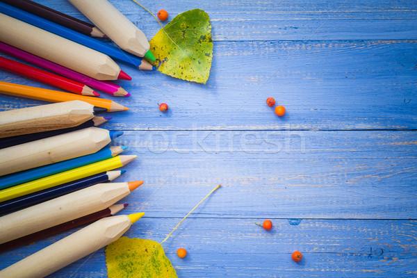 Vintage background colored pencils autumn fruits blue table Stock photo © fotoaloja