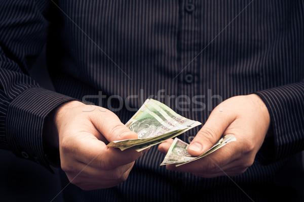 Closeup man counting money Polish Stock photo © fotoaloja