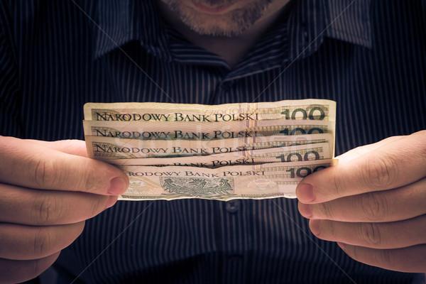 Polish banknotes hands man Stock photo © fotoaloja