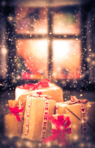 Christmas gifts rustic table window dark snowing Stock photo © fotoaloja