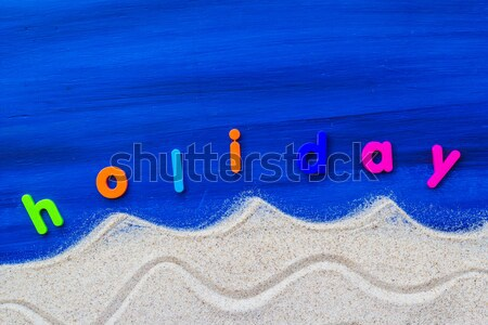 word holiday laid sand blue board Stock photo © fotoaloja