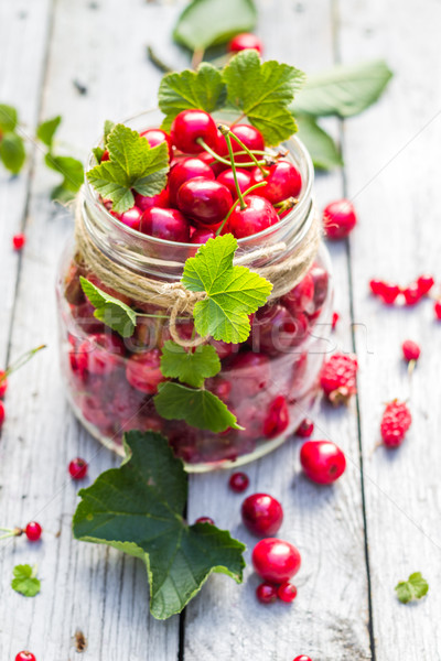 Glass jar full of fruits cherries and currants Stock photo © fotoaloja