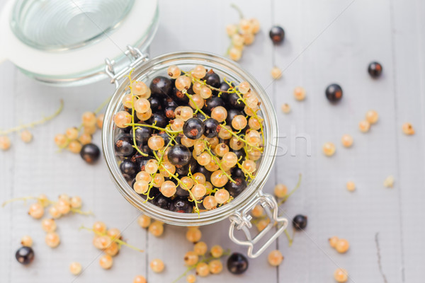 fruits black and white currants jar wooden table Stock photo © fotoaloja