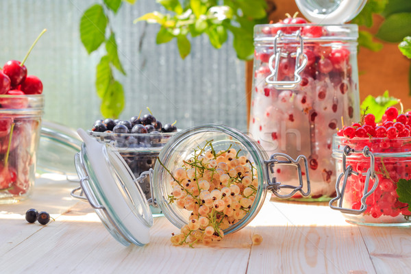 Preparation products processed fresh colorful summer fruits jars Stock photo © fotoaloja