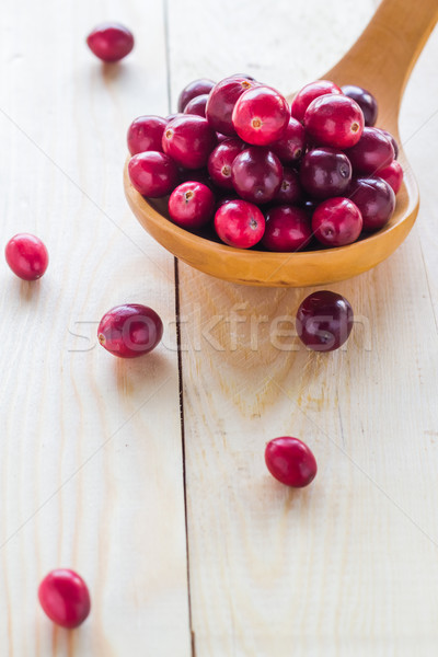 Cranberries wooden spoon background berry Stock photo © fotoaloja