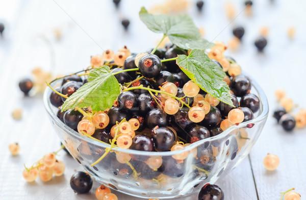 Fruits white black currants saucer wooden table Summer harvest Stock photo © fotoaloja