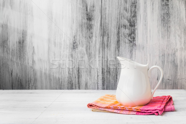Still life white jug kitchen cloth Stock photo © fotoaloja