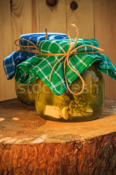 Pickled cucumbers jars wooden table Stock photo © fotoaloja