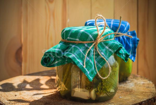 Pickled cucumbers jars wooden table Stock photo © fotoaloja