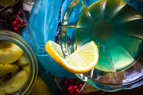 alcohol quince liqueur sliced fruit jar wooden cups Stock photo © fotoaloja