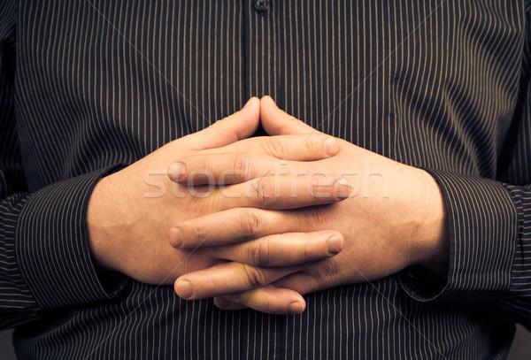Homme shirt pliées mains main Photo stock © fotoaloja