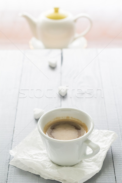 Coffee cup with milk and sugar cubes scattered Stock photo © fotoaloja
