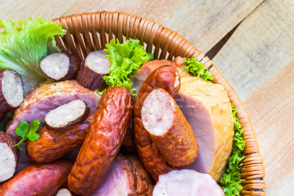 Sausage meat basket wooden table space text Stock photo © fotoaloja