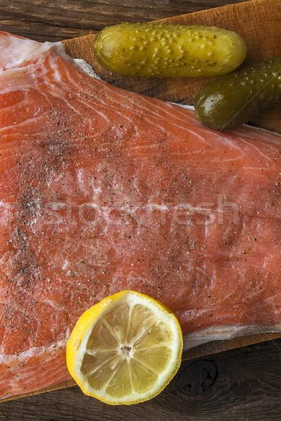 Poissons saumon brut tranche planche à découper manger Photo stock © fotoaloja